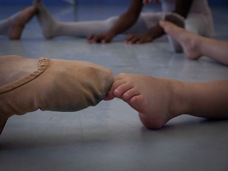 Photo of dancer's toe shoes and students toes
